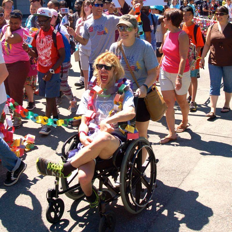 March participant celebrating the ADA