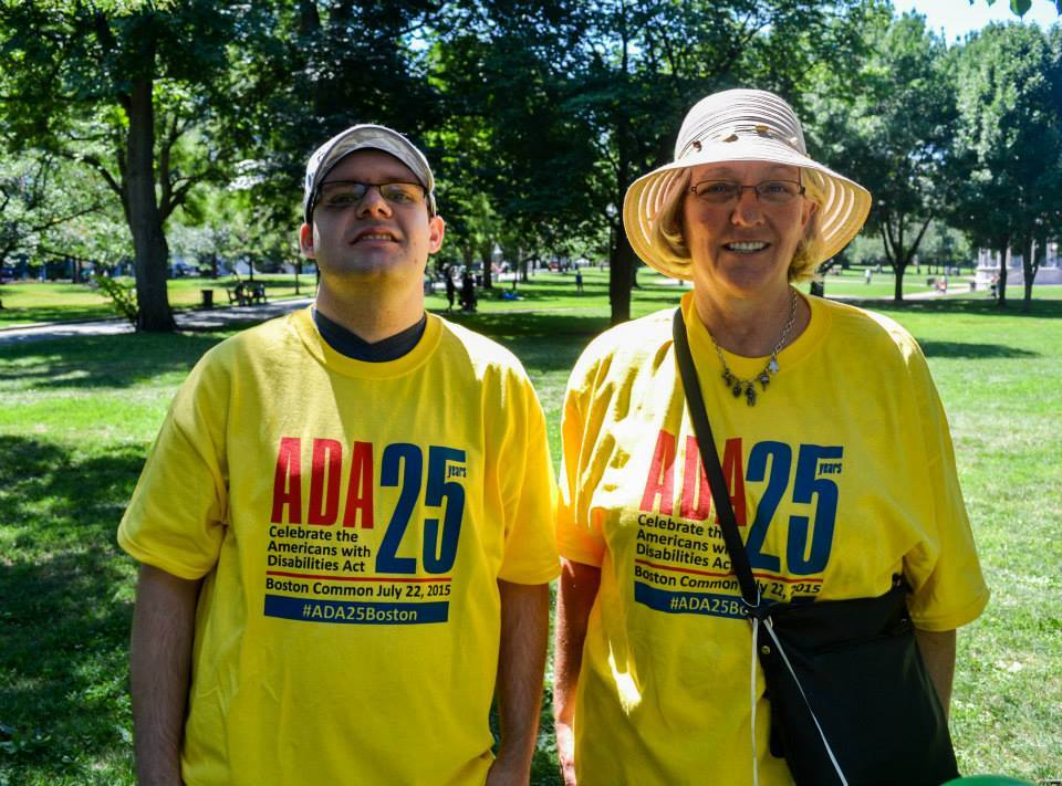 Two volunteers in their yellow ADA 25 Boston Common t-shirts