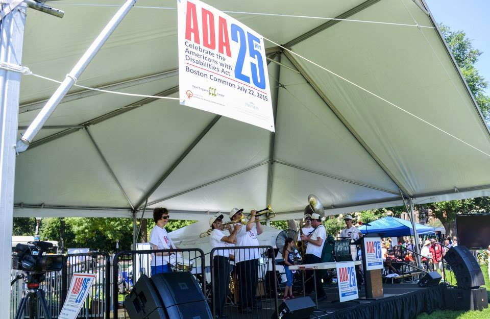 Hot Tamales Brass Band performing on stage after the ADA celebration march