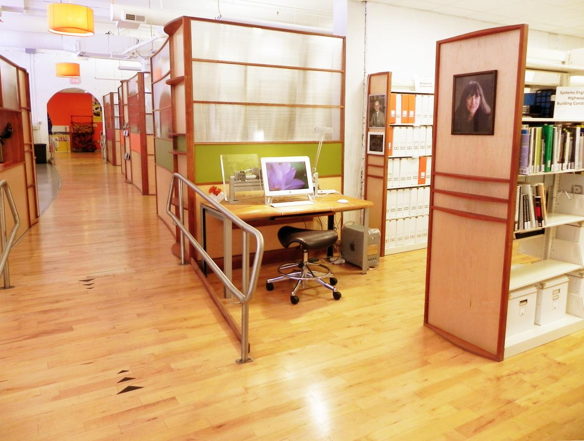 The library at IHCD including a ramp access to the kitchen and a workstation